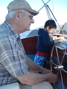 Hector Jourdain and his youngest grandson on bridge of the Bluefin